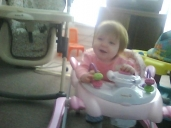 My grandaughter Matilda in her new walker
