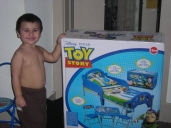 Justin and his new Toy Story bedset he got for his birthday