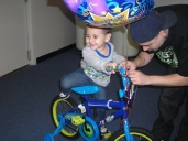 Justin on his new Buzz Lightyear bike