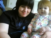 My daughter Jessica holding her daughter Matilda